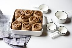Growing up, my Dad and Grandmawould always make us cinnamon rolls from  scratch. I remember the way the dough smells. I remember the way you have  to clear off the entire counter to roll out the dough and turn it into a  swirly snake of cinnamon and sugar. And then I also remember the five total  times my parents caved and let us buy Pillsbury cinnamon rolls (where my  siblings and I would fight over the center one like idiots). I have no idea  what I was thinking or what was so tempting…