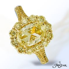 JB Star Natural fancy yellow diamond ring featuring a magnificent 1.50 ct oval FY diamond surrounded by 12 round fancy yellow diamonds and accented by fancy yellow micro pave.