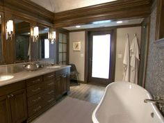 Dark wood, translucent screens and tiled walls create a rich and inviting spa setting.
