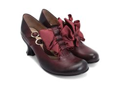 John Fluevog: Baroque Caravaggios, in burgundy. These are so strange, almost grotesque, yet I love them, with their fussy bows and six-sided heels in a practical height. I think I've a hat or two that would look lovely with these...