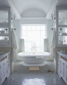 a freestanding tub in a white bathroom