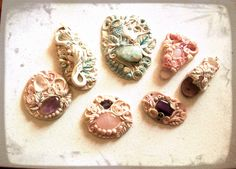 Artisan clay jewels with healing stones