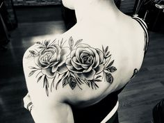 Rose shoulder tattoo in black & shading #roseshouldertattoos #TattooIdeasShoulder
