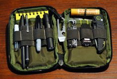 My EDC pouch (Maxpedition Mini Pouch). Contents: Gaurdian folding knife, 2 GB USB drive, paper clips, Rite in the Rain notepad, mini sharpie, Zebra 0.5mm mechanical pencil, Fischer space ball point pen, Streamlight Microstream 1A flashlight, Nite Ize Doohickey, Leatherman Style PS Multitool, Burt's Bees lip balm, Trifold wallet (not shown - pocket behind knife), Gold cologne mini spray bottle .
