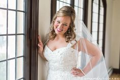 Gorgeous bride on her wedding day.  Pink and grey inspired wedding at the beautiful St Cecilia's church and stunning Renaissance Hotel. The bride and grooms location for portraits completed their meaningful and timeless style.  Cincinnati Wedding Photographer Amanda Donaho Photography