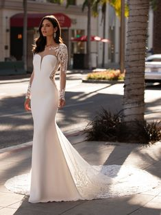 Fall in love with our BACALL mermaid wedding dress in crepe with long sleeves. Discover the 2021 Cruise collection at our Pronovias stores Types Of Wedding Gowns, Dream Wedding Dresses, Bridal Dresses, Pronovias Wedding Dress, Couture Wedding Gowns, Backless Wedding, Boho Wedding, Tattoo Lace, Long Sleeve Wedding