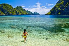 beach travel no zika - Picture of a woman walking at Star Beach, El Nido, Phillippines