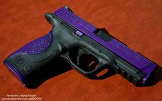 Smith & Wesson and its purple, oh my must talk to our gun guy about getting mine done!! Love it:)