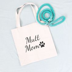Mutt Mom Tote Bag. These simply designed canvas tote bags will be the shopping bag you reach for time and time again. They are roomy enough to hold all your essentials but not so large that you feel like you're lugging a suitcase around. Made from lightweight cotton canvas, they are not only durable but both classic and trendy. 10% of your purchase is donated to help dogs in need at local animal shelters. Dog Mom Gifts, Dog Lover Gifts, Dog Lovers, Animals And Pets, Cute Animals, Animal Shelters, Heath Bars, Draft Horses, Pet Life