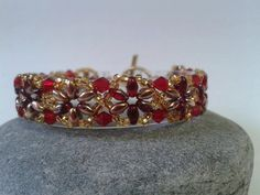 Red and gold with siam crystals bracelet by EnlightenedSpirit