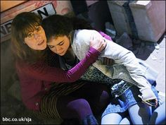 Sarah Jane Smith and Maria take shelter in a scene from The Sarah Jane Adventures: Invasion Of The Bane. Bbc Class, Sarah Jane Smith, Doctor Who Companions, Broadchurch, Orphan Black, Torchwood, Sherlock Bbc, Bane, Dr Who