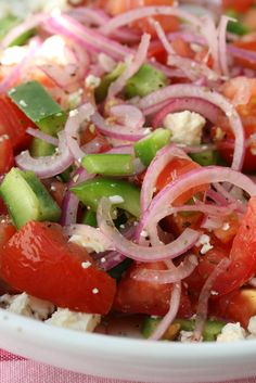 Salad with tomato, red onion, green pepper and feta. Sprinkle with oregano & black pepper. Drizzle with red wine and olive oil, add a dash of lemon juice