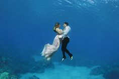 This is an amazing shoot shot by amazing people: Love and Water. Featuring my Silke and Joelle Gowns. *please do not attempt. These are experienced free divers. Underwater photography, trash the dress, wedding, hawaii, clear water, wedding photography, destination wedding, elopement