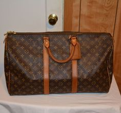 Great condition Louis vuitton keepall 50 no heavy scuffing , no water marks, corners good condition handle strong at the base, zipper work properly inside the bag clean and come with luggage tag Authenticity code Made in France Feel free to make an offer Louis Vuitton Luggage, Louis Vuitton Monogram, Authenticity, 50th, Handle, Strong, Base, France, Zipper