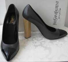 "YSL pumps. Grey, point toe with black patent leather tip. Features wood heel. Heel height 4 1/2""."
