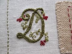 Fred's Wife  get the pattern from Mary Corbett's  http://www.needlenthread.com/2014/06/monograms-for-hand-embroidery-delicate-spray-d-e-f.html