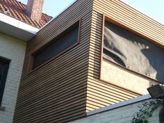 gevelbekleding in plato hout - in combinatie met geschilderde bestaande gevel