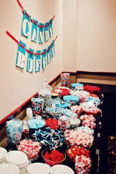 Love this color coordinated candy buffet! Photo by Angeli. #minenapolisweddingphotographers #weddingfavors