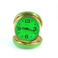 Green Seth Thomas Travel Alarm Clock Vintage Leather Works ($28) ❤ liked on Polyvore featuring home, home decor, clocks, green clock, vintage home decor, vintage green clock, green home decor and green home accessories