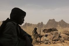 Members of the rebel group the Sudan Liberation Army, led by Abdul Wahid (SLA-AW), sit on a mountain top that they are defending from the Sudanese Army in Central Darfur, Sudan, March World Photography, Photography Awards, Haunting Photos, People Of The World, The New Yorker, Award Winner, Photojournalism, National Geographic, Egypt
