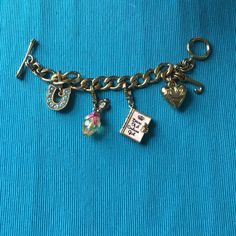 Juicy Couture Charm Bracelet Juicy Couture Charm Bracelet. Never worn comes with box. Charms did not come with the bracelet but were purchased separately and added on but will be sold all together. NWOT Juicy Couture Jewelry Bracelets