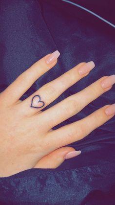 wedding band ring finger heart tattoo