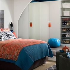 White bedroom with orange and blue accents | Bedroom decorating - love the arch to define the closet area