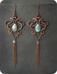 earrings. Don't like chains much, but like entwined top