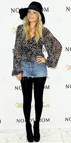 Nicole Richie - the bohemian designer tops off a patterned blouse and jean skirt with another floppy hat.