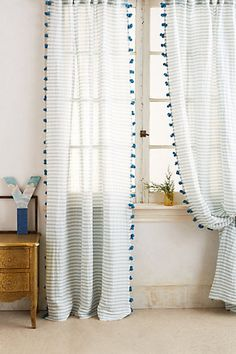 pom tassel curtain #anthrofave #homedecor
