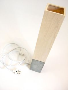 petite concrete table lamp with wood veneer lampshade.