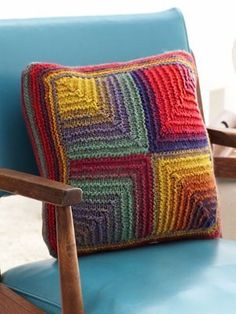 Transport yourself to the days of bell bottoms and Woodstock with the crazy colorful Mod Mosaic Pillow. This 60s-inspired knit pillow pattern is the perfect way to brighten up your living space as well as learn how to knit a mitered square.