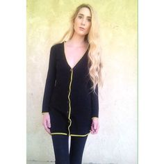 Black and lime green long cardigan Black long cardigan. Has like green outlines. Has buttons down the middle and 2 pockets on the front Forever 21 Jackets & Coats
