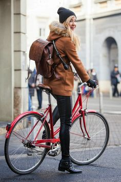 Winter Bike Style: Ditch the Black! Love the coat, pants, backpack, all on a chili pepper red Dutchi!