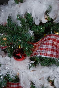 Christmas Tree 2013.  White Feather Boas, Wide Ribbon, and Lots, Lots, Lots of Glitter.