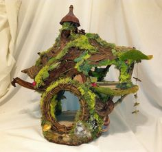 Custom made to order fairy house / dollhouse/ two story with rope ladder. Contact: forstwim@sonic.net
