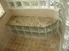 Shower with glass block enclosure and seat