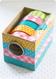 DIY: washi tape dispenser Can be used for ribbons also. I'm thinking bottom of cereal box and paper towel roll.