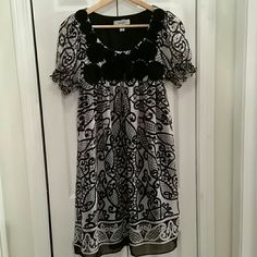 c1a6d3603736e Baby doll dress Cute black and white baby doll dress from DressBarn. Sheer  top layer