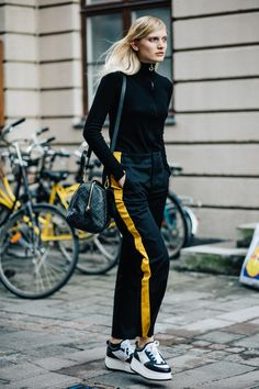 Kill Bill 90s inspired track pant worn back with roll neck sweater and stacked sneakers Saved by Gabby Fincham