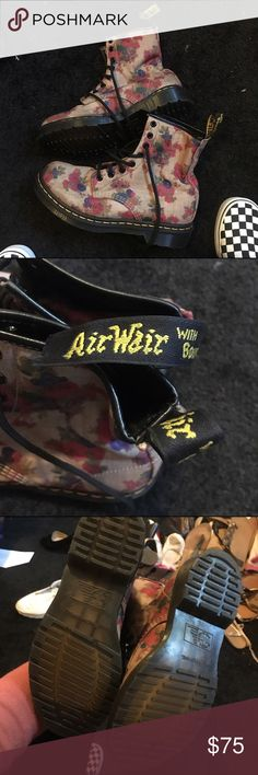 Like new floral Dr Martens These Dr Martens are in amazing condition since they've only been worn once or twice, only flaw is the little pull tab is detached from the inside, an easy fix. Very comfortable and like new condition. Dr. Martens Shoes Lace Up Boots