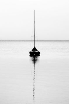 I adore black and white photography. There is such an innocence to it that covers all of the colorful flaws of a colored image. The asymmetrical line that is created in this image by the boats sail and water reflection is what caught my eye. Black N White, Black White Photos, Black And White Photography, Ligne D Horizon, Minimalist Photography, Belle Photo, Monochrome, Sailing, Reflection