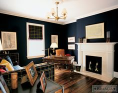 Navy blue study with plaid day bed and Roman shade - Alessandra Branca