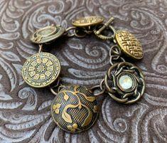 Antique and Vintage Button Bracelet Bronze Charm Bracelet Button Bracelet, Bracelets, Bronze, Antique Necklace, Vintage Buttons, Black Enamel, Bead Art, Bracelet Making, Charmed
