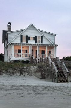 Such a sweet house perched on the beach.