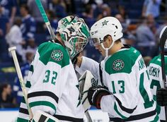 TAMPA, FL - OCTOBER 15: Goalie Kari Lehtonen #32 the Dallas Stars celebrates the win against the Tampa Bay Lightning with teammate Mattias Janmark #13 at the Amalie Arena on October 15, 2015 in Tampa, Florida. (Photo by Scott Audette/NHLI via Getty Images)