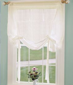 Semi sheer tie-up curtain for a simple farmhouse look from Country Curtains...bathroom window