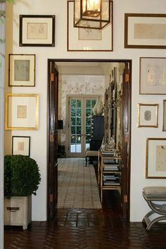 I Need Your Help! Eclectic Gallery Walls - laurel home | beautiful art display around a door by Windsor Smith