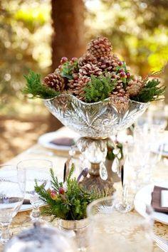 Pine Cones and short evergreen branches make an inexpensive fall or winter wedding centerpiece idea.  #BridesVillage.com