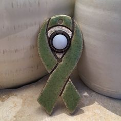 The green ribbon is used as a symbol of support for protecting the environment.  It represents organ donation and missing children. It brings awareness and hope for curing kidney cancer, cerebral palsy & Lyme disease.